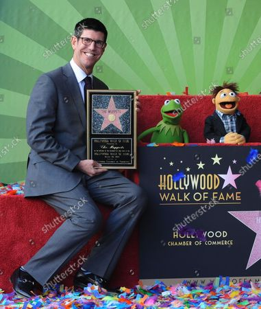 Walt Disney Studios President Rich Ross (L)  attends the Inimitable Muppets unveiling ceremony honoring The Muppets  with the 2,466th star on the Hollywood Walk of Fame in Los Angeles on March 20, 2012.