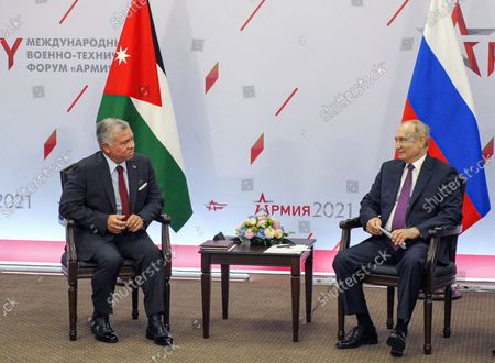 """Russian President Vladimir Putin (R) speaks with King of Jordan Abdullah II (L) during their meeting at the International Military-Technical Forum """"Army-2021"""" held in the Patriot Park, in Kubinka outside Moscow, Russia, 23 August 2021."""