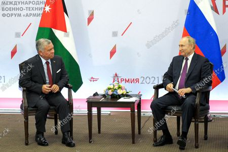 Russian President Vladimir Putin, right, and Jordan's King Abdullah II speak, during their meeting on the side of the International Military Technical Forum Army-2021 in Alabino, outside Moscow, Russia