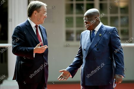 Prime Minister of North Rhine-Westphalia Armin Laschet (L) welcomes the President of the Republic of Ghana, Nana Akufo-Addo (R), prior to the ceremony marking the founding of North Rhine-Westphalia state 75 years ago, at the racecourse in Duesseldorf, Germany, 23 August 2021.