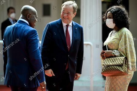 Prime Minister of North Rhine-Westphalia Armin Laschet (C) welcomes the President of the Republic of Ghana, Nana Akufo-Addo (L) and his wife, prior to the ceremony marking the founding of North Rhine-Westphalia state 75 years ago, at the racecourse in Duesseldorf, Germany, 23 August 2021.