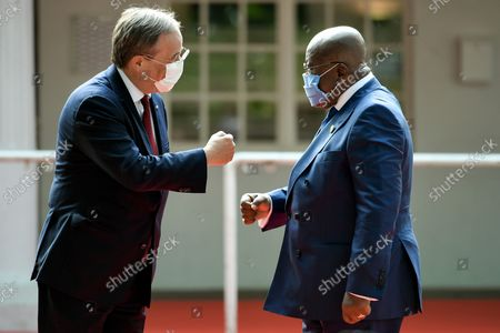 Stock Image of Prime Minister of North Rhine-Westphalia Armin Laschet (L) and the President of the Republic of Ghana, Nana Akufo-Addo (R), fist bump as they arrive for the ceremony marking the founding of North Rhine-Westphalia state 75 years ago, at the racecourse in Duesseldorf, Germany, 23 August 2021.