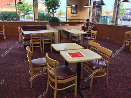 A lone diner sits in a fast-food restaurant during the novel coronavirus (COVID-19) pandemic in Toronto, Ontario, Canada on August 22, 2021. Ontario's daily COVID-19 case count continues to move upward to levels not seen in more than two months, with officials reporting 722 cases on Sunday and two additional deaths. 522 or 78 per cent of Sunday's cases involved people who were unvaccinated, partially vaccinated or had an unknown vaccination status. 158 or 22 per cent of Sunday's case count involved fully vaccinated individuals.
