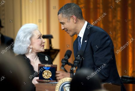 President Barack Obama presents Eunice David, the wife of musician Hal David, with a Gershwin Prize honoring her husbands work during a concert honoring him and fellow prize recipient Burt Bacharach, in the East Room at the White House in Washington on May 9, 2012.