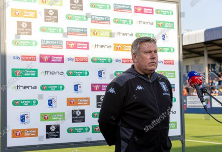 Craig Shakespeare of Aston Villa in front of the Carabao branded board