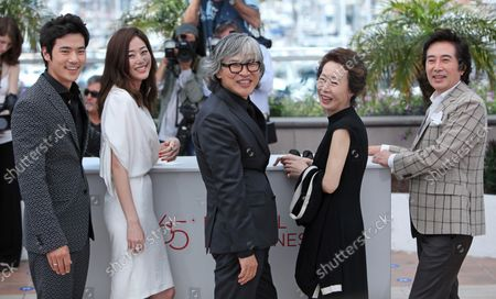 """(From L to R) Kim Kang-Woo, Kim Hyo-Jin, Im Sang-Soo, Youn Yuh-Jung and Baek Yoon-Sik arrive at a photocall for the film """"Do-Nui Mat (The Taste of Money)"""" during the 65th annual Cannes International Film Festival in Cannes, France on May 26, 2012."""