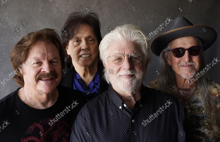 Members of the Doobie Brothers, from left, Tom Johnston, John McFee, Michael McDonald and Pat Simmons pose for a portrait at Show Biz Studios in Los Angeles on . The band has a tour and album out this fall