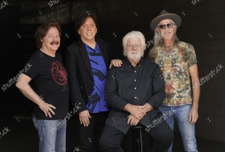 Stock Image of Members of the Doobie Brothers, from left, Tom Johnston, John McFee, Michael McDonald and Pat Simmons pose for a portrait at Show Biz Studios in Los Angeles on . The band has a tour and album out this fall