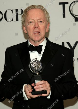 """Bob Crowley poses for photographers after winning the 2012 Tony Award for """"Best Scenic Design of a Musical"""" for his work with """"Newsies"""" during the 66th Annual Tony Awards held at the Beacon Theatre on June 10, 2012 in New York City."""