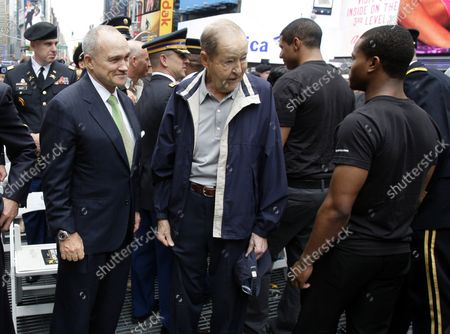 NYPD Police Commissioner Raymond Kelly greets United States Army recruits after being sworn in by U.S. Chief of Staff Gen. Raymond T. Odierno accompanied by the U.S. Army Band in Times Square on Flag Day in New York City on June 14 2012.