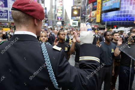 U.S. Army Chief of Staff Gen. Raymond T. Odierno (R) swears in United States Army recruits, accompanied by the U.S. Army Band in Times Square on Flag Day in New York City on June 14 2012.