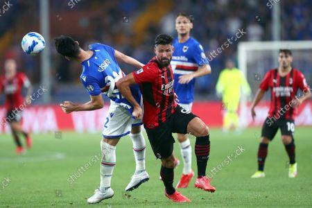 Olivier Giroud of Ac Milan and Maya Yoshida of Uc Sampdoria battle for the ball during the Serie A match between Uc Sampdoria and Ac Milan at Stadio Luigi Ferraris.