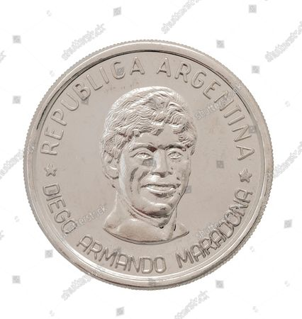 Stock Image of Alfredo Di Stefano Diego Maradona Coin.  An epic collection of medals, trophies, shirts and personal items relating to footballing legend Alfredo Di Stefano is being sold by his family for over £1m.  Many of the awards won by the great goalscorer have, until recently, been on display at the Real Madrid Museum, the club where he played for most of his career.  The Argentine-born striker is regarded as one of the best players of all-time and is often compared to Cristiano Ronaldo.   During Di Stafano's time with Real Madrid in the 1950s and '60s, the Spanish giants dominated European football, largely due to his goals and assists.