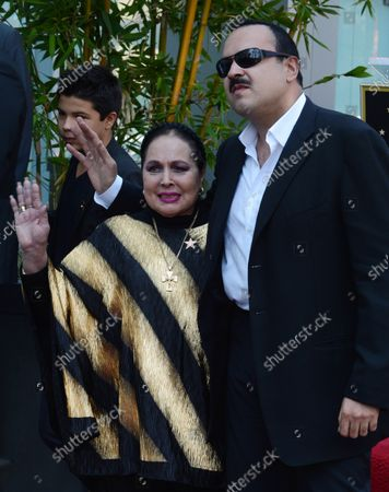 Latin singing star Pepe Aguilar of Mexico, poses with his mother, actress and ranchero singer Flor Silvestre, during a ceremony honoring him with the 2,474th star on the Hollywood Walk of Fame in Los Angeles on July 26, 2012.