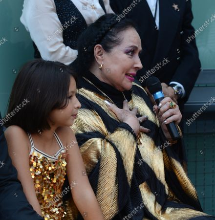 Flor Silvestre makes comments to her son, Latin singing star Pepe Aguilar of Mexico, , during a ceremony honoring him with the 2,474th star on the Hollywood Walk of Fame in Los Angeles on July 26, 2012.
