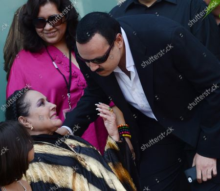 Stock Photo of Latin singing star Pepe Aguilar of Mexico, is greeted by his mother Flor Silvestre during a ceremony honoring him with the 2,474th star on the Hollywood Walk of Fame in Los Angeles on July 26, 2012.