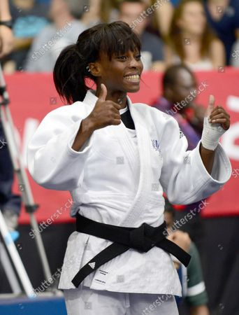 Priscilla Gneto of France celebrates her victory over Ilse Heylen of Belgium in the Women's Judo 52kg Bronze Medal match at the London 2012 Summer Olympic Games on July 29, 2012 in London.