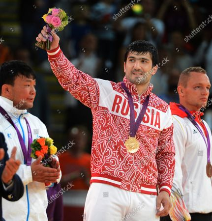 Men's 100KG Judo gold medal winner Tagir Khaibulaev of Russia at the holds the flowers at the ExCel center at the London 2012 Summer Olympics on August 2, 2012 in London.  T