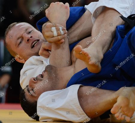 Dimitri Peters of Germany (White) tangles with gold medalist Tagir Khaibulaev of Russia in Men's 100KG Judo in the semifinals at the ExCel center at the London 2012 Summer Olympics on August 2, 2012 in London.  The Russians took gold in Men's 100kg.