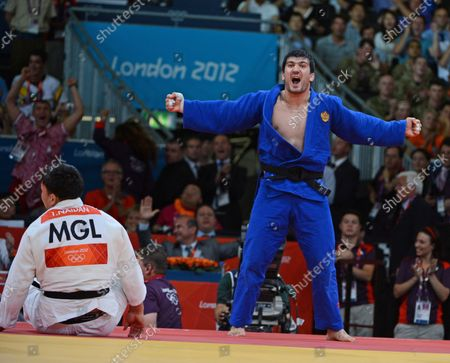 Gold medalist Tagir Khaibulaev of Russia celebrates defeating Tuvshinbayar Naidan of Mongolia (L) in Men's 100KG Judo in the semifinals at the ExCel center at the London 2012 Summer Olympics on August 2, 2012 in London.  The Russians took gold in Men's 100kg.