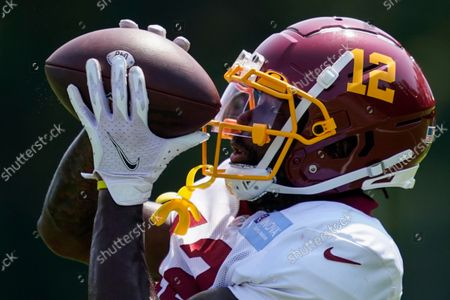 Stock Picture of Washington Football Team wide receiver Tony Brown (12) catches a pass during practice at the team's NFL football training facility, in Ashburn, Va