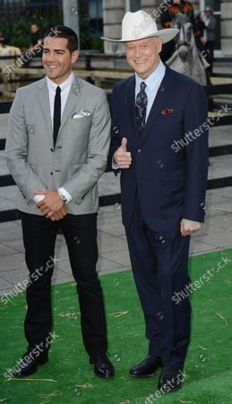 """American actors Jesse Metcalf and Larry Hagman attend the launch of Channel 5's """"Dallas"""" at Old Billingsgate in London on August 21, 2012."""