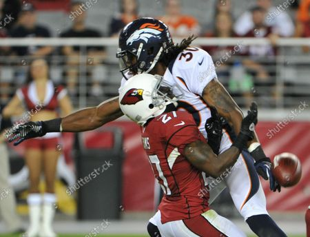Arizona Cardinals punt receiver Michael Adams (L) is run into by Denver Broncos David Burton (R) in the fourth quarter of the Cardinals-Broncos pre-season game at University of Phoenix Stadium in Glendale, Arizona, August 30,2012. Burton was called for interference with a receiver on the play. The Broncos beat the Cardinals 16-13.