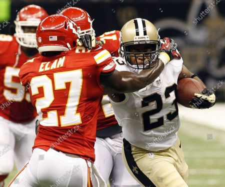 New Orleans Saints running back Pierre Thomas (23) take a Drew Brees pass up the field for 27-yards  during second quarter action at the Mercedes-Benz Superdome in New Orleans, Louisiana on September 23, 2012. Defending on the play is Kansas City Chiefs free safety Abram Elam (27).
