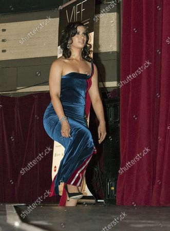 Local actress Anita Majumdar steps onstage at the Vogue Theatre for director Deepa Mehta's film Midnight's Children in which she stars for the opening gala film at the Vancouver International Film Festival in Vancouver, British Columbia on September 27, 2012. UPI Photo /Heinz Ruckemann