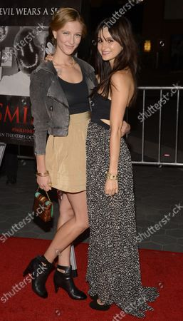 """Cast members Caitlin Gerard (L) and Melanie Papalia attend the premiere of the horror film """"Smiley"""" at the AMC Universal Citywalk Stadium 19 in Los Angeles on October 9, 2012."""