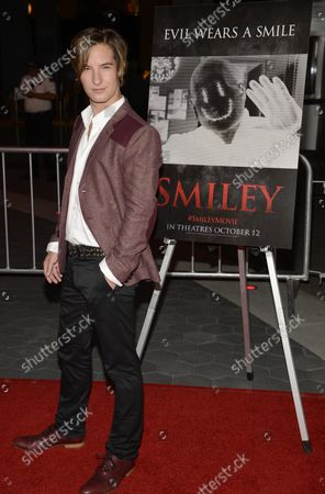 """Cast member Andrew James Allen attends the premiere of the horror film """"Smiley"""" at the AMC Universal Citywalk Stadium 19 in Los Angeles on October 9, 2012."""