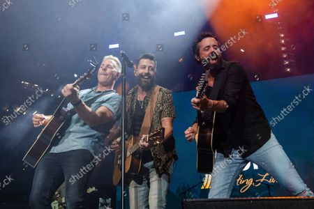 Stock Picture of Trevor Rosen, from left, Matthew Ramsey and Brad Tursi of Old Dominion perform at the 2021 ACM Party for a Cause at Ascend Amphitheater, in Nashville, TN