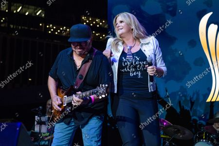 Trisha Yearwood, right, performs at the 2021 ACM Party for a Cause at Ascend Amphitheater, in Nashville, TN