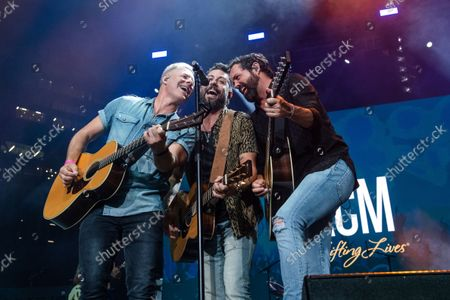 Trevor Rosen, from left, Matthew Ramsey and Brad Tursi of Old Dominion perform at the 2021 ACM Party for a Cause at Ascend Amphitheater, in Nashville, TN