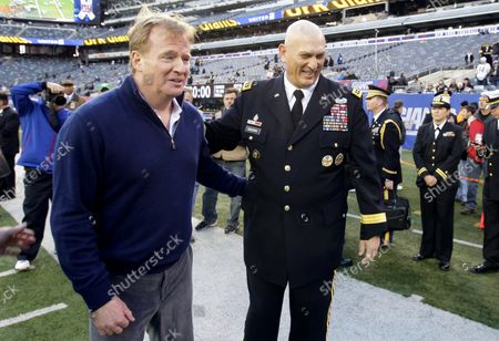 """NFL Commissioner Roger Goodell greets the 38th Chief of Staff of the U.S. Army Raymond T. """"Ray"""" Odierno on the field before the New York Giants play the Pittsburgh Steelers in week 9 of the NFL season at MetLife Stadium in East Rutherford, New Jersey on November 4, 2012. The game comes just 5 days after Hurricane Sandy strikes the north east section of the United States."""