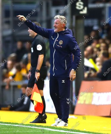 Newport County assistant manager Wayne Hatswell gestures on the touchline, in charge in the absence of manager Michael Flynn through covid-19