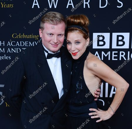 Producer Kris Lythgoe and actress Becky Baeling arrive at the BAFTA LA Britannia Awards presented by BBC America, at the Beverly Hilton Hotel in Beverly Hills, California on November 7, 2012.