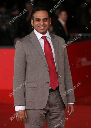 """Neil D'Souza arrives on the red carpet for the film """"Italian Movies"""" during the 7th annual Rome International Film Festival in Rome on November 12, 2012."""