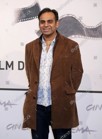 """Neil D'Souza arrives at a photo call for the film """"Italian Movies"""" during the 7th annual Rome International Film Festival in Rome on November 12, 2012."""
