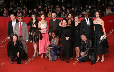 """The cast of the film """"Italian Movies"""", including director Matteo Pellegrini and actors Aleksei Guskov, Anita Kravos, Neil D'Souza and Harvey Virdi, arrives on the red carpet before the film's premiere during the 7th annual Rome International Film Festival in Rome on November 12, 2012."""