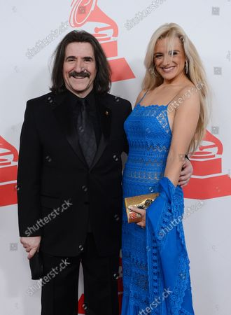 President of The Latin Recording Academy Luis Cobos  and Patricia Cobos arrive for the Latin Recording Academy Person of the  Year Tribute to Caetano Veloso at the MGM Grand Garden Arena in Las Vegas, Nevada on November 14, 2012.