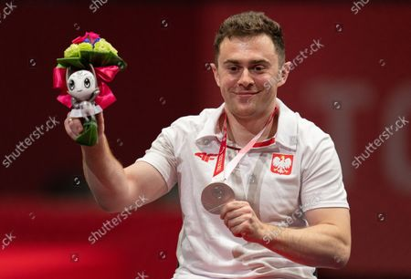 Adrian Castro POL Silver Medallist in the Wheelchair Fencing Men's Individual Sabre Category B on the Podium in the Makuhari Messe Hall B. Tokyo 2020 Paralympic Games, Tokyo, Japan, Wednesday 25 August 2021.