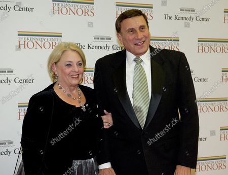 United States Representative John Mica (Republican of Florida) and his wife, Patricia, arrive for the formal Artist's Dinner honoring the recipients of the 2012 Kennedy Center Honors hosted by United States Secretary of State Hillary Rodham Clinton at the U.S. Department of State in Washington, D.C. on December 1, 2012.  The 2012 honorees are Buddy Guy, actor Dustin Hoffman, late-night host David Letterman, dancer Natalia Makarova, and the British rock band Led Zeppelin (Robert Plant, Jimmy Page, and John Paul Jones).