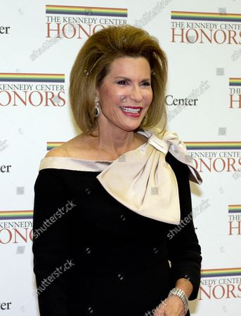 Ambassador Nancy Goodman Brinker, founder and CEO of Susan G. Komen for the Cure Foundation, arrives for the formal Artist's Dinner honoring the recipients of the 2012 Kennedy Center Honors hosted by United States Secretary of State Hillary Rodham Clinton at the U.S. Department of State in Washington, D.C. on December 1, 2012.  The 2012 honorees are Buddy Guy, actor Dustin Hoffman, late-night host David Letterman, dancer Natalia Makarova, and the British rock band Led Zeppelin (Robert Plant, Jimmy Page, and John Paul Jones).