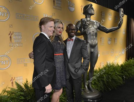 Stock Picture of SAG-AFTRA Executive Vice President Ned Vaughn (L-R), Busy Philipps and Taye Diggs pose for photographers after announcing the 19th annual Screen Actors Guild Awards nominations at SilverScreen Theater at the Pacific Design Center in West Hollywood, California on December 12, 2012. The SAG Awards will be presented on January 27, 2013