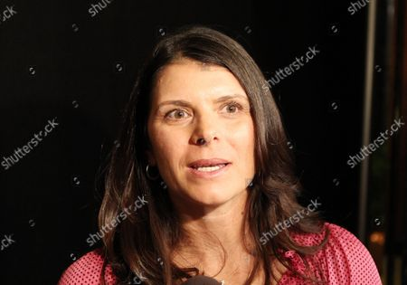 U.S. Olympic women's soccer player Mia Hamm talks with reporters at the Missouri Athletic Club in St. Louis on January 11, 2013. Hamm was on hand to learn that Junior midfielder Crystal Dunn from the University of North Carolina and junior forward Patrick Mullins from the University of Maryland, been selected as the best male and female NCAA Division 1 Soccer Players of the Year, earning them the Hermann Trophy.