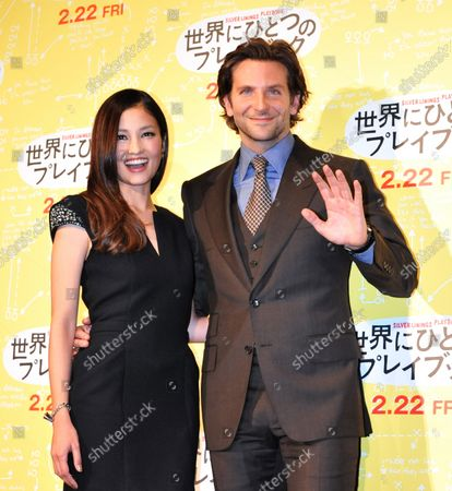 """Actors Bradley Cooper (R) and Meisa Kuroki attend a stage greeting during the Japan premiere for the film """"Silver Linings Playbook"""" in Tokyo, Japan, on January 24, 2013. The film opens on February 22 in Japan."""