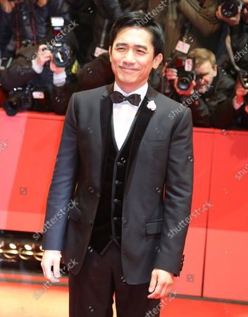 """Tony Leung Chiu Wai arrives on the red carpet for the film """"The Grandmaster"""" during the opening of the 63rd Berlinale Film Festival in Berlin on February 7, 2013."""