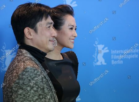 """Tony Leung Chiu Wai (L) and Zhang Ziyi arrive at the photo call for the film """"The Grandmaster"""" during the opening of the 63rd Berlinale Film Festival in Berlin on February 7, 2013."""