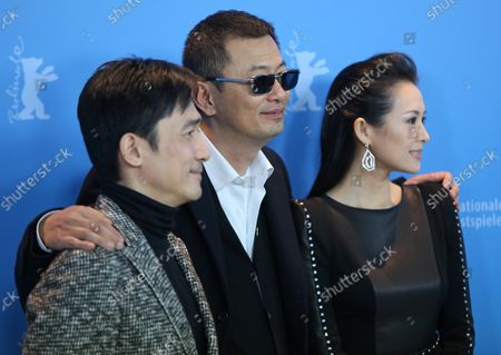 """Tony Leung Chiu Wai (L), Wong Kar Wai (C) and Zhang Ziyi arrive at the photo call for the film """"The Grandmaster"""" during the opening of the 63rd Berlinale Film Festival in Berlin on February 7, 2013."""